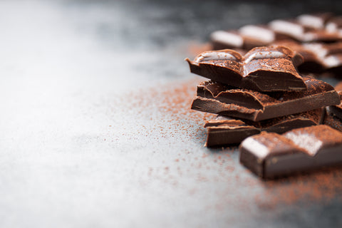 pieces-chocolate-wooden-table-cacao-sprinkled