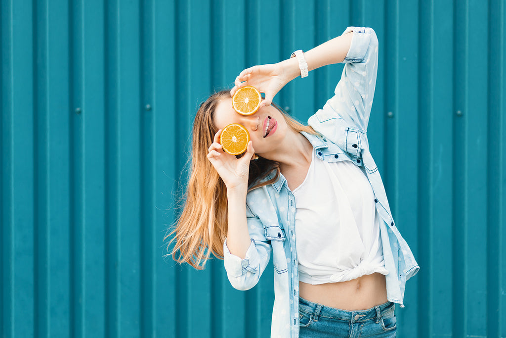 young-woman-holding-orange-slices