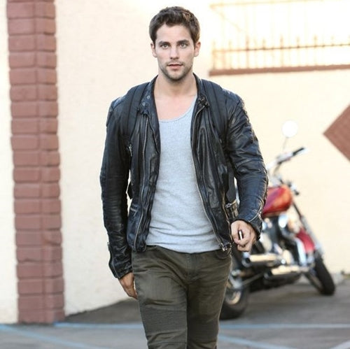 Brant Daugherty in a black leather jacket