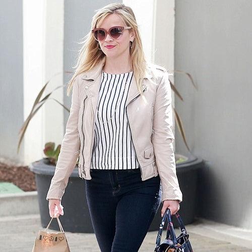 Reese Witherspoon in a beige leather motorcycle jacket