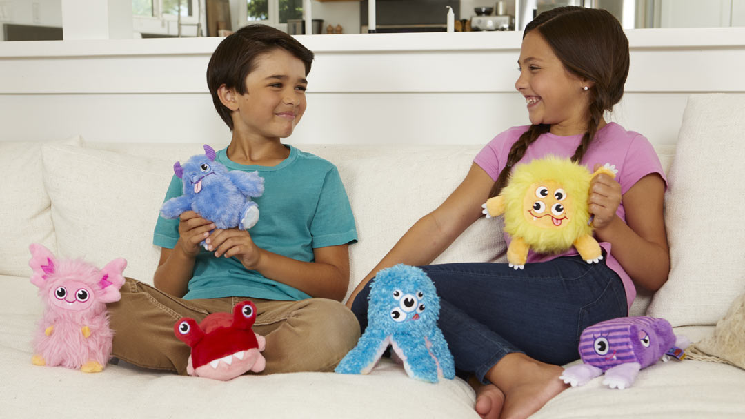 House Monsters hanging out on the couch with two child pals