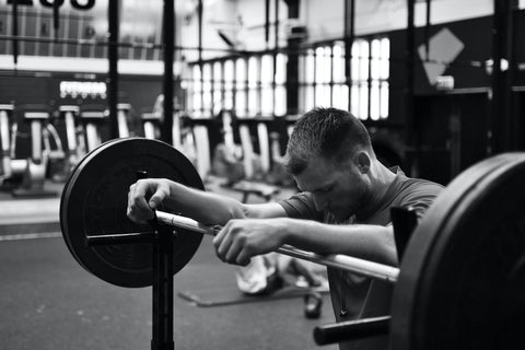 lifter alone in the gym black and white
