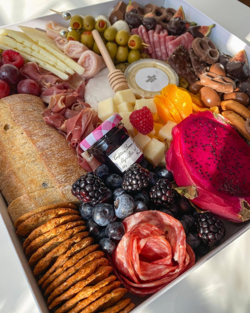 Luxury charcuterie boxes, boards, platters and cones
