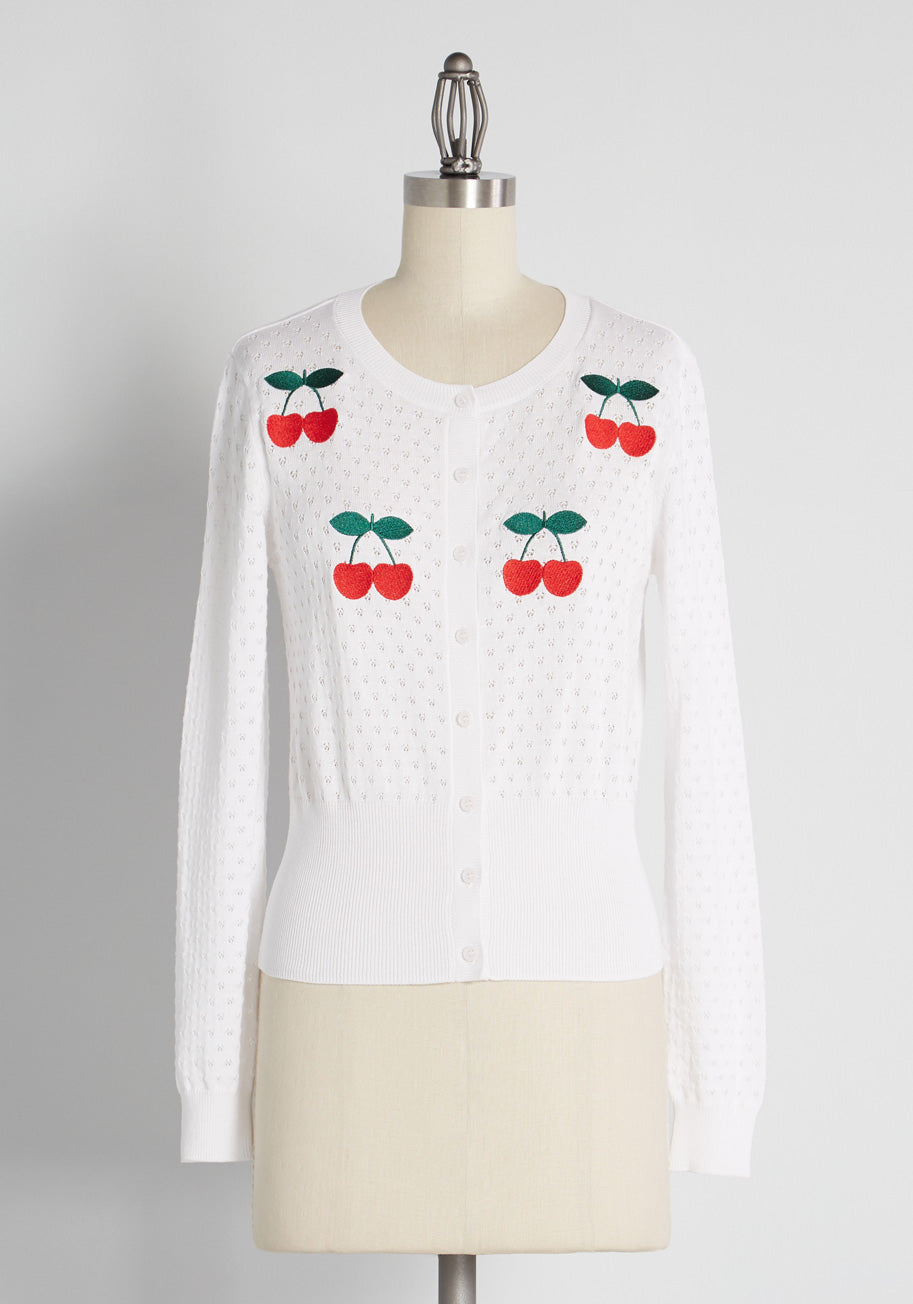 What Did Women Wear in the 1950s? 1950s Fashion Guide ModCloth Perfect Pickings Pointelle Cardigan in White Size 4X $59.99 AT vintagedancer.com