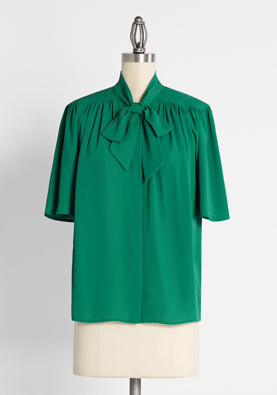1940s Blouses, Shirts, Knit Tops Fashion History ModCloth Graceful Grandstand Tie-Neck Blouse in Green Size 4X $49.99 AT vintagedancer.com