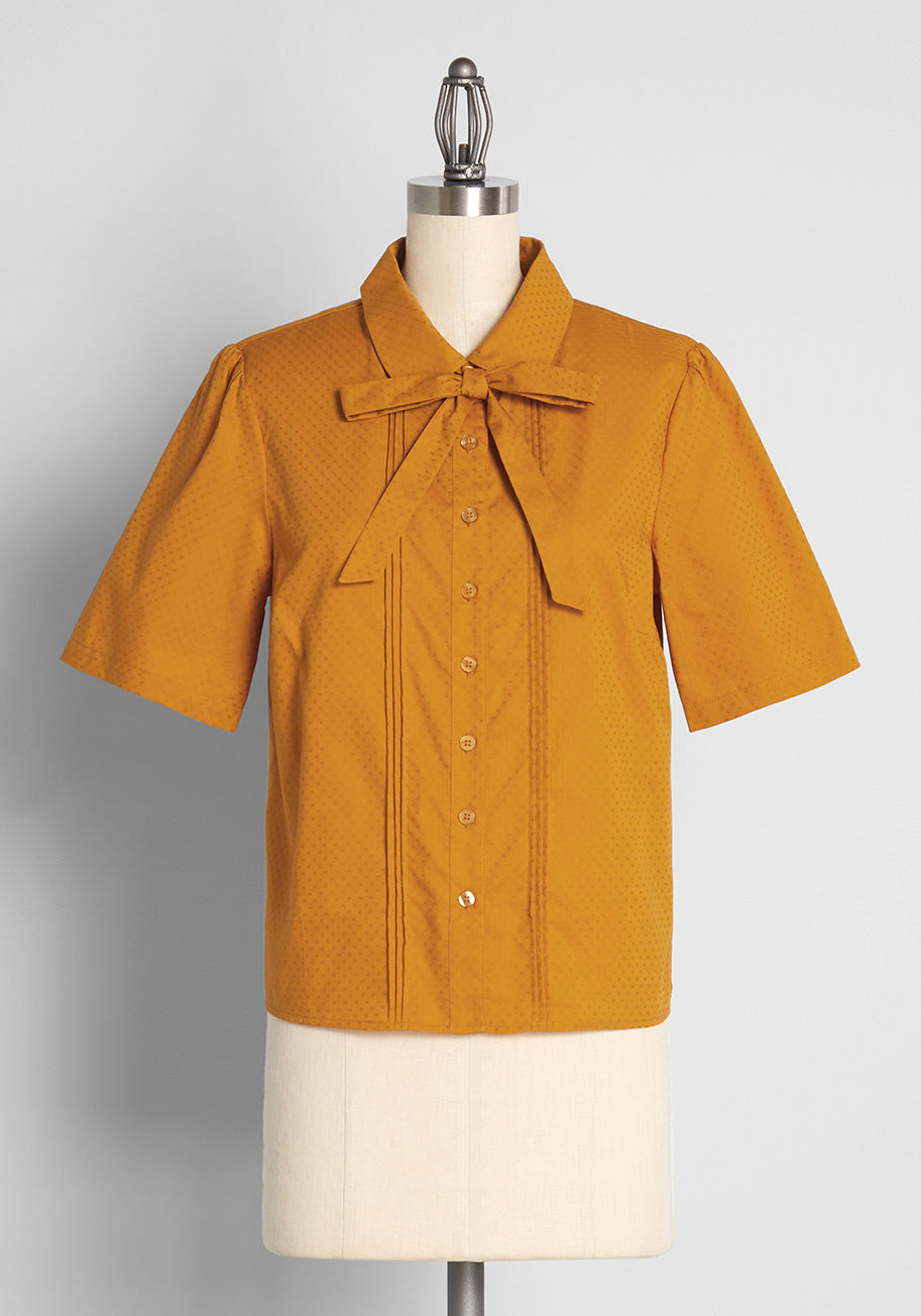 What Did Women Wear in the 1950s? 1950s Fashion Guide Princess Highway Merry Times in Marigold Tie-Neck Blouse Size 16 $55.00 AT vintagedancer.com