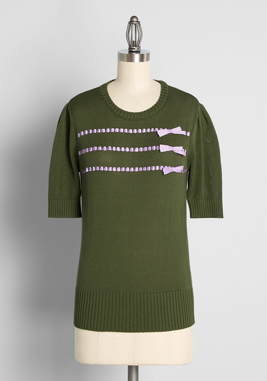 1940s Teenage Fashion: Girls ModCloth Keeping It Bow-tiful Short Sleeve Sweater Purple in Green Size 4X $65.00 AT vintagedancer.com