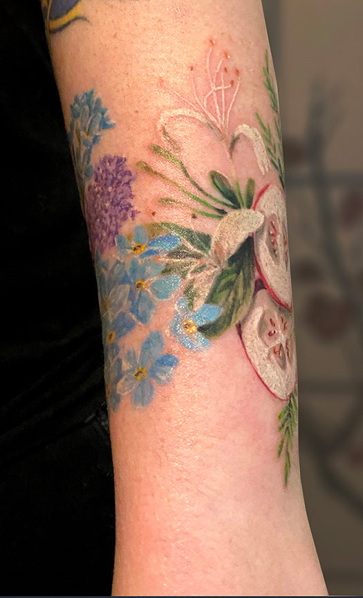water colour tattoo on wrist