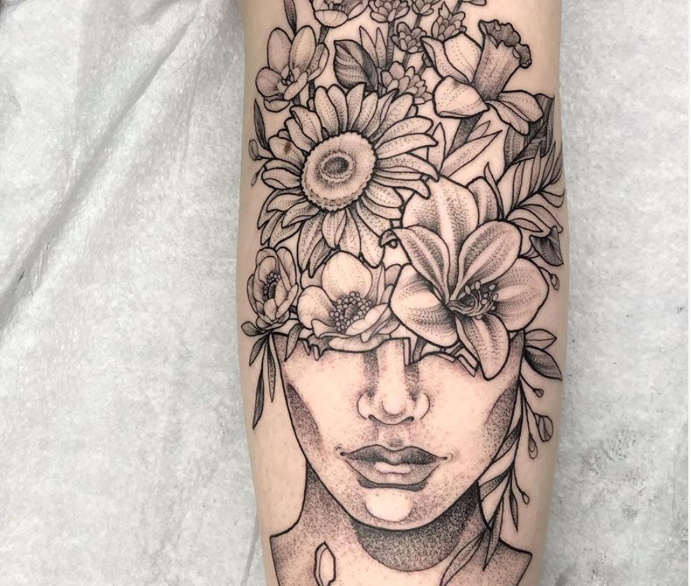 fine line style tattoo of a flower hat woman