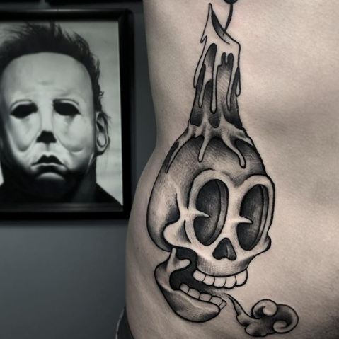 skull with candle tattoo