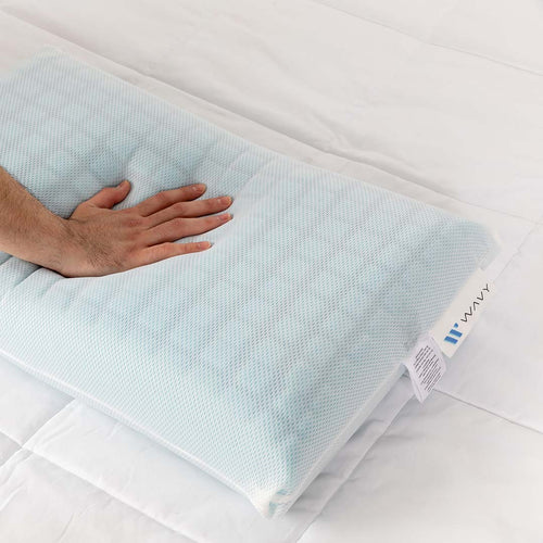 Blue pillow with pressure applied by hand