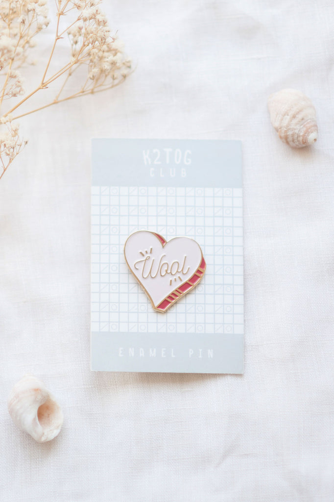 k2tog club wool heart enamel pin