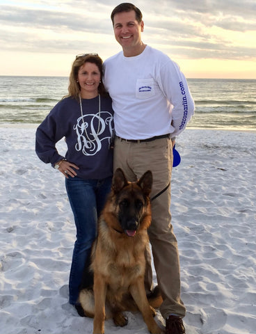 Robert Pruitt and his wife and dog on the beach in Destin, Fla.