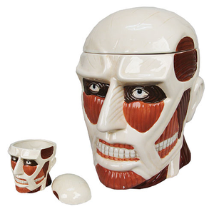 Lidded cookie jar shaped as colossus from Attack on Titan
