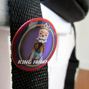 Close up of King Friday button