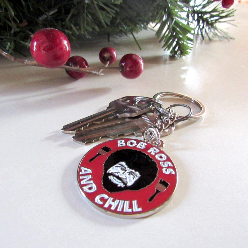 Bob Ross and Chill keychain next to Christmas decorations