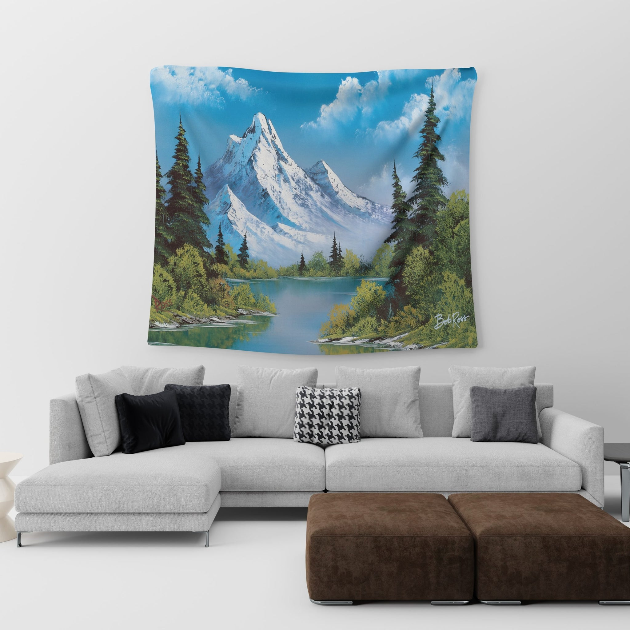 Bob Ross mountain tapestry hanging in a living room
