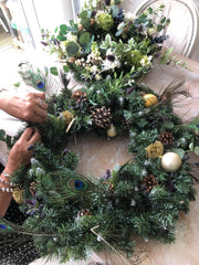 A partially constructed wreath on a table.