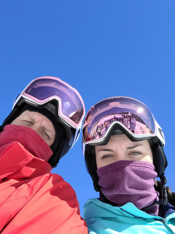 Skier and Snowboarder selfie under a clear, blue sky.