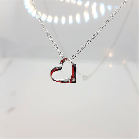 sterling silver suspended heart pendant