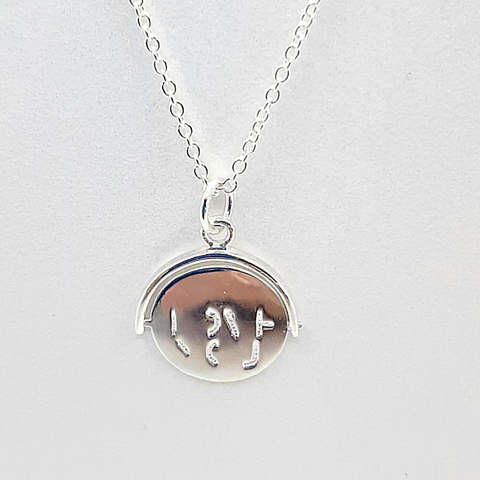 Sterling silver spinning I LOVE YOU necklace
