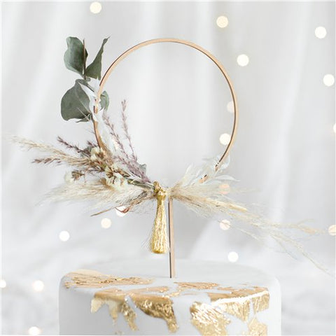 a wooden hoop cake topper decorated with flowers