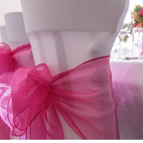 White chair with pink sash