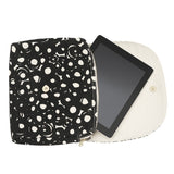 Circle print black and coral clutch