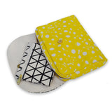 Circle print black and yellow canvas clutch
