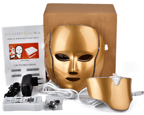 LED Face Mask Therapy instrument packaging with user manual, adapter, remote, and cables.