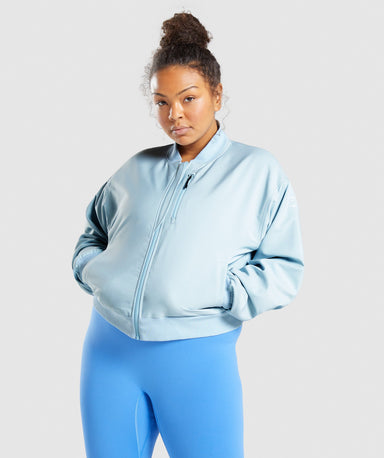 Shop Gymshark Essential Bomber - Light Blue From GS | AROS