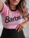Shop Barbie x Skinnydip Pink & Black Logo Cropped T-Shirt From SDL | AROS