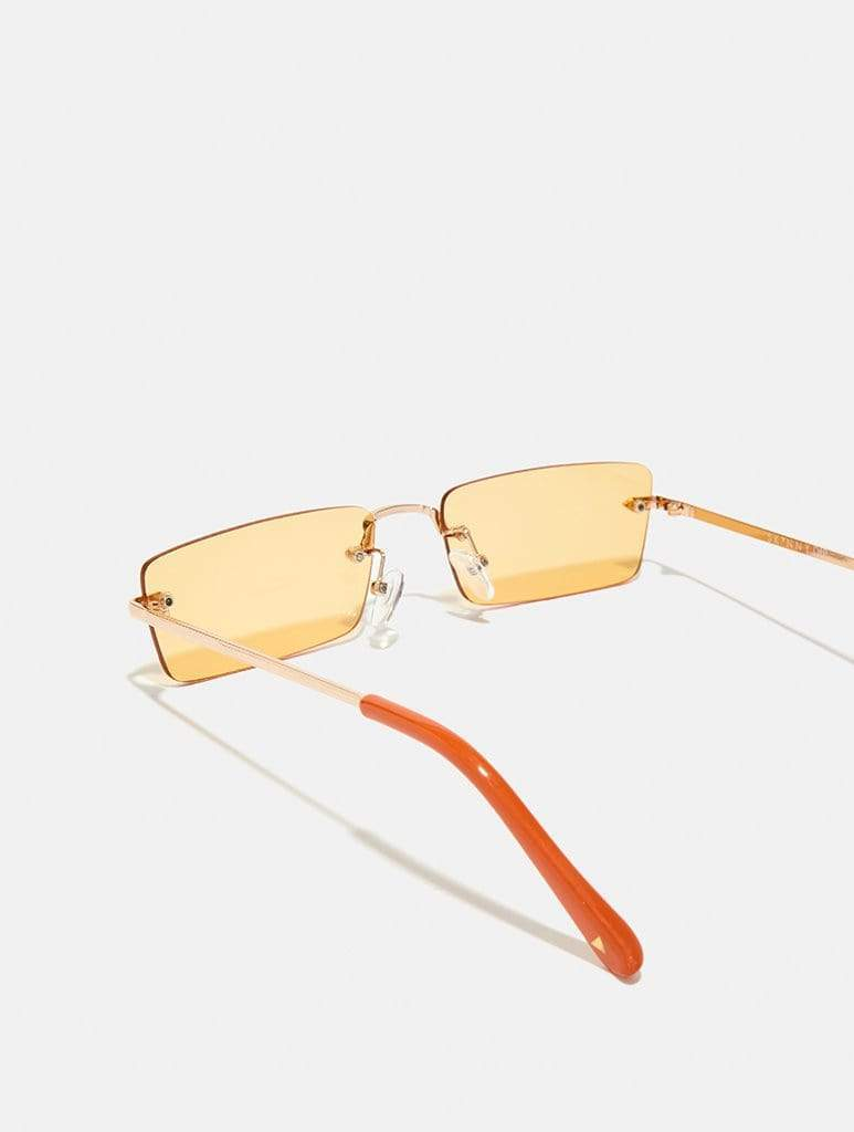 Shop Orange Frameless Sunglasses From SDL | AROS