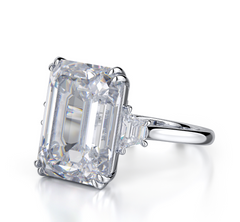 EMERALD CUT THREE-STONE DIAMOND RING
