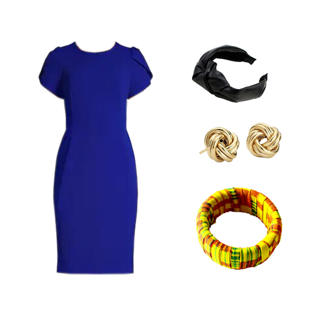 A solid-coloured dress, enhanced by a Coo-Mon accessory.