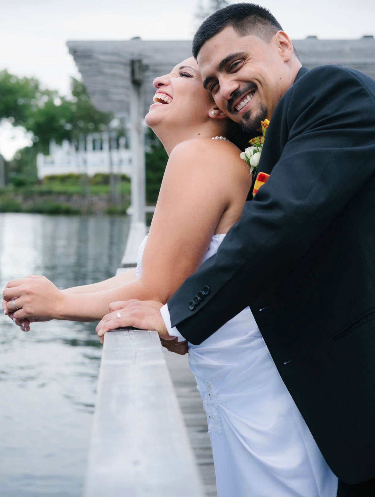 Beautiful wedding photo of Alexandra and Yoann, wearing a set of bow tie, suspenders and a pocket square made of a yellow Madras fabric from Coo-Mon.