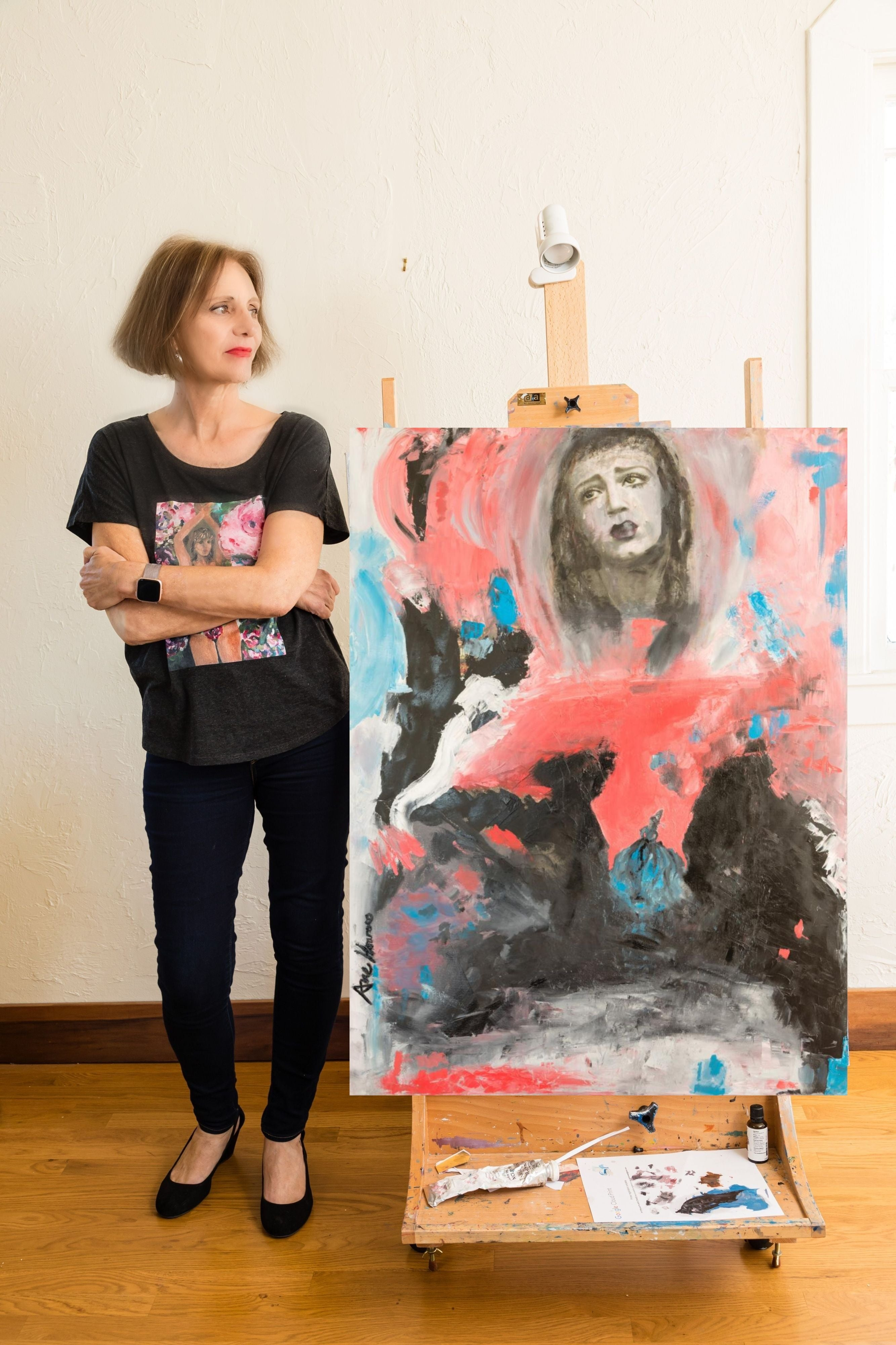 Ane Howard in front of painting