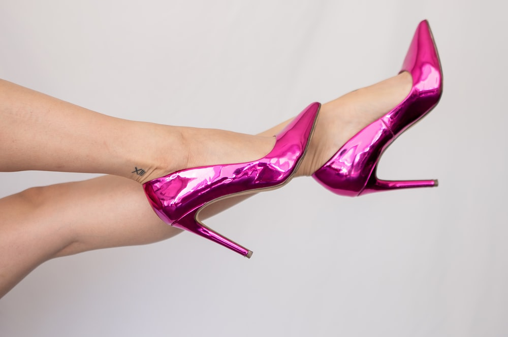 A person wearing pink high heels.