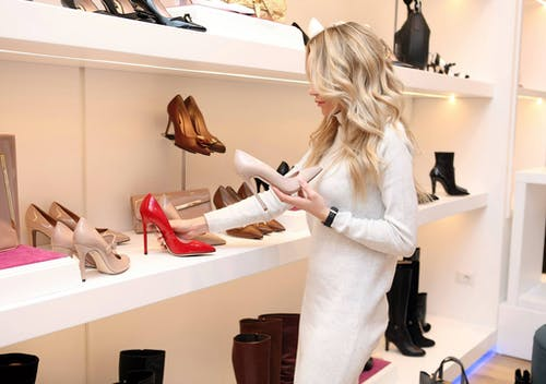 a woman buying pumps at a shoe store
