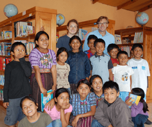 Jim and his daughter with students in their Library