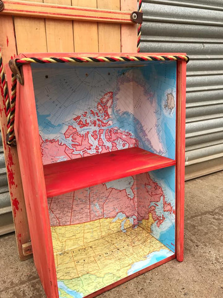 Upcycled bookcase with map lining