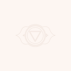 Tan graphic of the third eye chakra symbol on a light pink background.