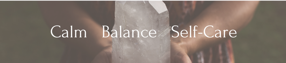 A woman stands holding a large crystal. The words 'Shop by Intention Calm Self-Care Healing Stones' appear over top