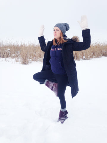 It can be tempting to stay inside and cozy up by the fire until the snow makes way for spring, but this year let's resolve to bundle up and get out to experience the quiet beauty of winter. Pre and Post-Natal yoga instructor Lara Reimer (@lbreimer) has created a quick heart opening yoga sequence for us to get outside and reconnect with nature.