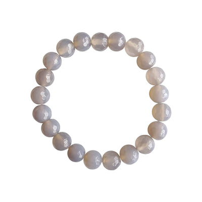 A close up image on a white background of a lavender agate gemstone stretch bracelet made with faceted 8mm beads.