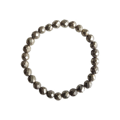 Close up on a white background of a Pyrite Gemstone Stretch Bracelet made with 6mm faceted pyrite beads.