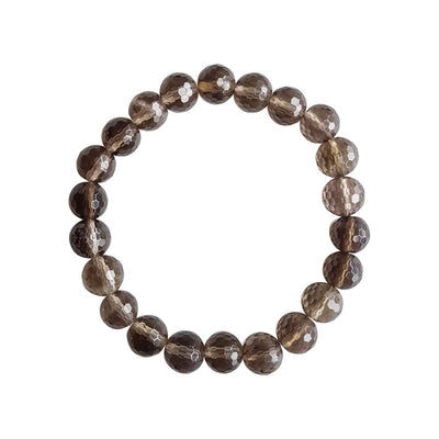 Close up image on a white background of a stretchy Smoky Quartz mala bracelet. The bracelet is made of 8mm faceted light brown Smoky Quartz beads.