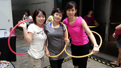 Hula hoop contest together with supportive friends.