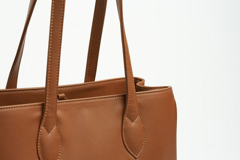 Details of a camel colored tote bag from KOVU brand made of E-Ultra leather