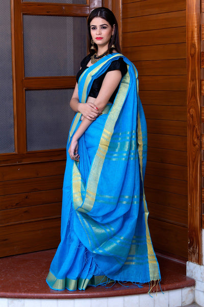 Cyan Blue Linen Saree With Golden Border